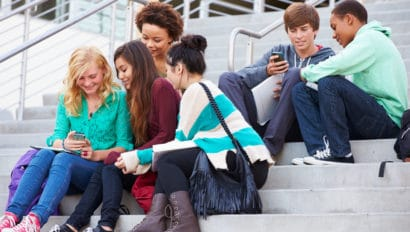 Students chatting on building steps